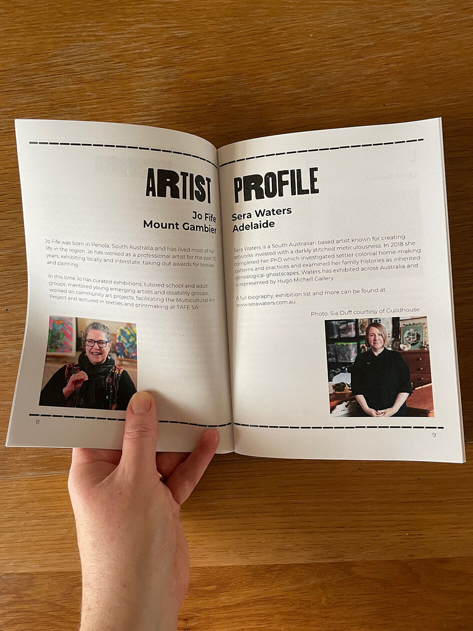 Photograph of the Telling tales booklet open to the artist profile pages