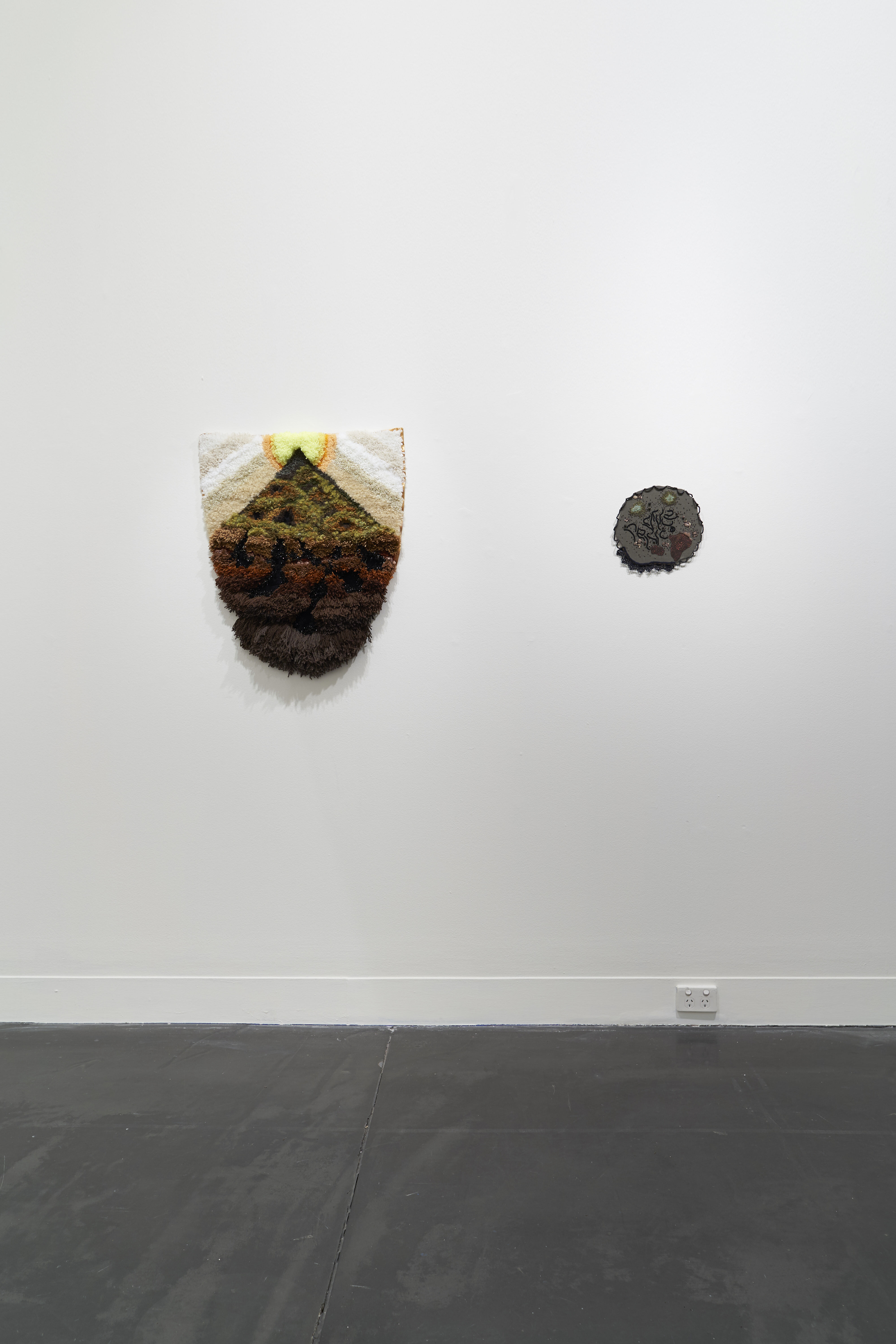 Specks by textile artist Sera Waters installed at Hugo Michell Gallery